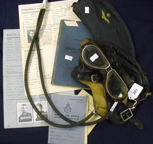Image of Lot  201  - A World War II bomber command collection to 1379166 W/O Leslie Rhodes RAFVR 619 squadron, Lancaster Air Gunner, comprising Air Gunners log book detailing operations in North Africa and Europe, pay book, service and release book, side hat, training helmet and goggles (Lewis Ltd), patches and brevets, together with German Personal Kartes relating to W/O Rhodes imprisonment as a POW in Stalag Luft 7 following and operational crash 10/05/1944 from which W/O Rhodes was the only survivor.