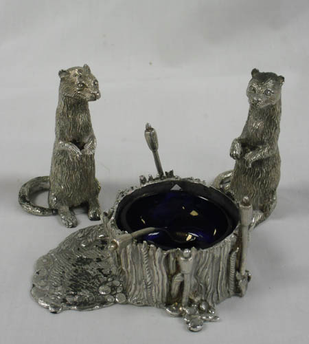Image of Lot  565  - A Garrards silver novelty condiment set modelled as standing otters and pond, approx 600 gr