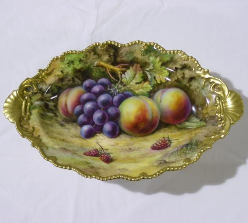 Image of Lot  196  - A Royal Worcester serpentine outline oval comport, painted with fruit on an earth ground, inscribed T Lockyer, puce factory mark, slight a/f, stress marks on base.