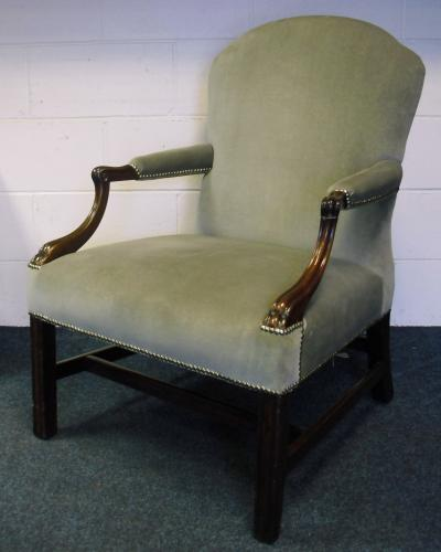 Image of Lot  495  - A Geo III mahogany upholstered armchair with scroll arms (one a/f) on square legs and double stretchers