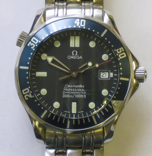 Image of Lot   89  - An Omega Seamaster Professional gent's full sized stainless steel cased automatic movement bracelet watch having blue textured dial and blue uni-directional bezel, with presentation boxes, international guarantee cards and handbook, c.2004
