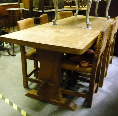 Image of Lot  588  - A Whittaker, Gnomeman of Liitlebeck adzed oak refectory table, together with six leather upholstered dining chairs, (chairs a/f). By repute tree supplied by H.M. The Queen Mother, from the Sandringham estate