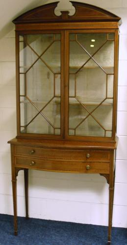 Image of Lot 1024  - An Edwardian mahogany and satinwood banded display cabinet on bowfronted base with two drawers and square tapering legs with spade feet, stamped Maple & Co Ltd