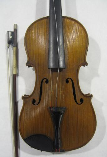Image of Lot  342  - A violin by Carlo Storioni having two-piece back, interior label ''Carlo Storioni Cremonensis Faciebat 1890''.  Body approx 355mm.  Together with a bow signed Wilhelm Muhl. Accompanied by a letter of provenance linking the violin to a Charle Alfred Holt (1886 - 1963) its long time owner & a life-long colliery worker.