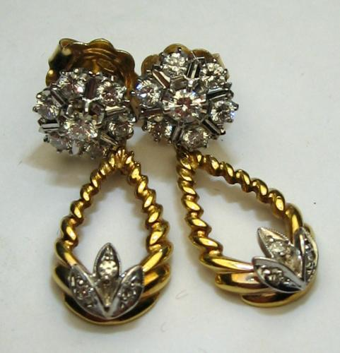 Image of Lot  142A  - A pair of pendant earrings each being unmarked yellow metal clusters set with seven brilliant cut white stones suspending an unmarked yellow metal open twist drops each set with brilliant cut white stones. Approx 33mm long