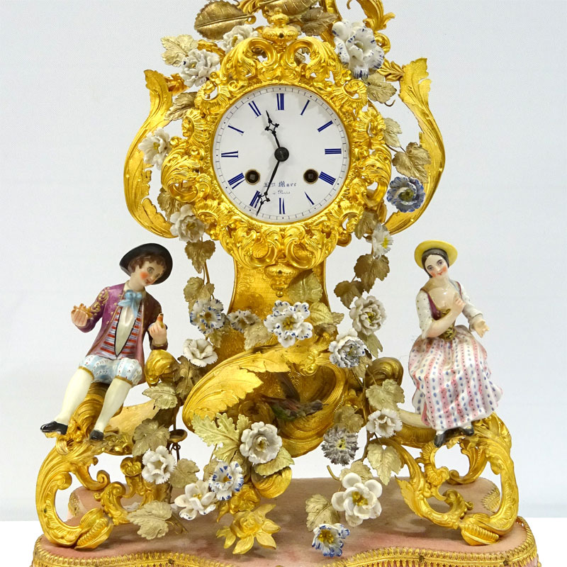 Image of Lot 1 - A French Louis XV style mantel clock having ormolu case with applied porcelain figurines & flowers