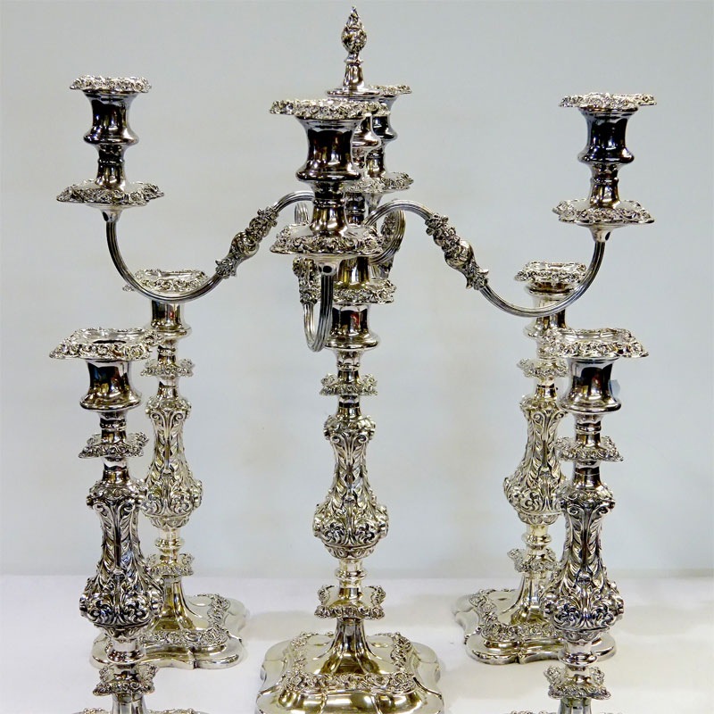 Image of Lot 216 - A silver plated four branch candelabra together with four matching silver plated candlesticks, one cap a/f