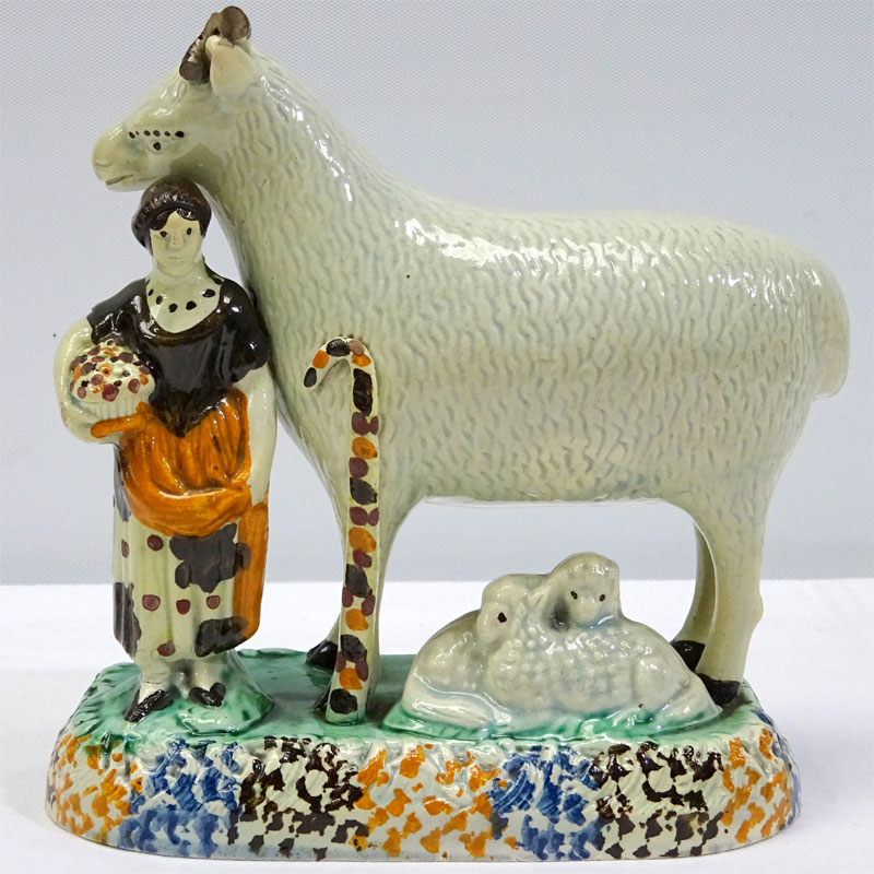 Image of Lot 312 - A Prattware shepherdess & sheep figure group, a/f horns lacking, c1800