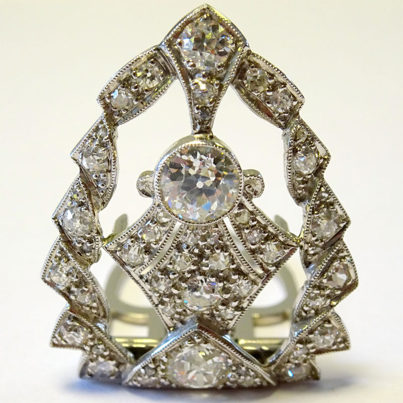 Image of Lot 137 - A clip brooch, unmarked white metal set with approximately 40 various brilliant cut white stones